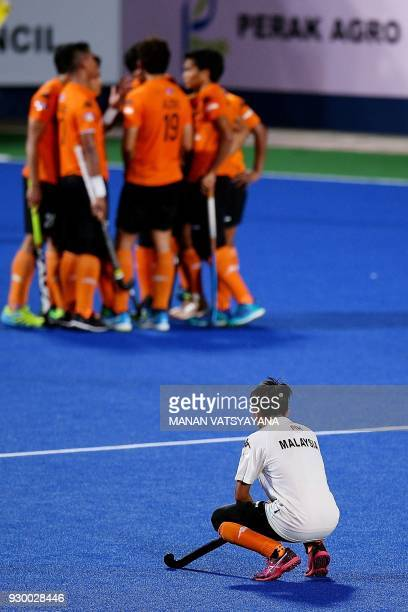 Malaysian hockey team players react after losing to Argentina during their men's field hockey thirdfourth place match of the 2018 Sultan Azlan Shah...