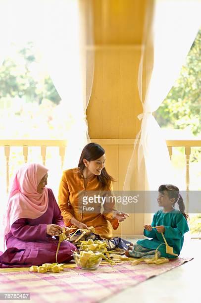 malaysian ketupats for hari raya - hari raya celebration stock pictures, royalty-free photos & images