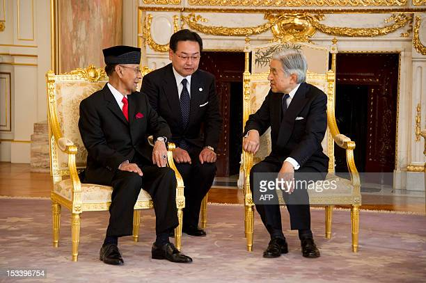 Malaysian King Abdul Halim Mu'adzam Shah and Japanese Emperor Akihito speak together at the official government guest house in Tokyo on October 5...