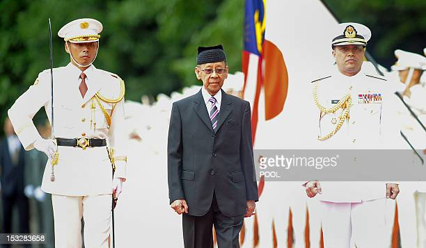 Malaysian King Abdul Halim Mu'adzam Shah reviews an honor guard during a welcoming ceremony at the Imperial Palace in Tokyo on October 3 2012 The...