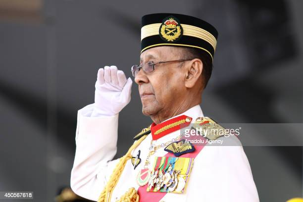 Malaysian King Abdul Halim Mu'adzam Shah salutes Malaysia's armed forces during the Trooping the Colour ceremony in conjunction with the Yang...