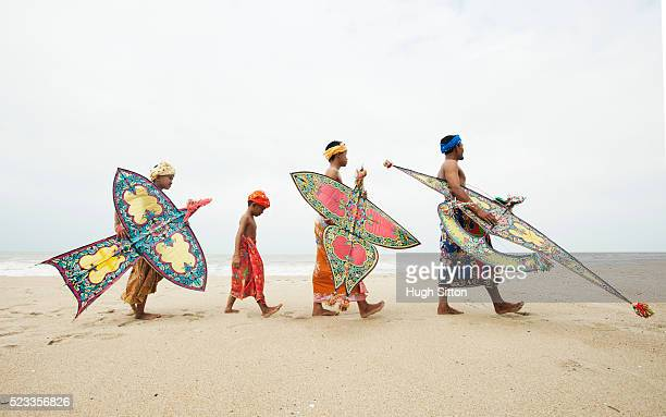 malaysian kite flyers - hugh sitton stock pictures, royalty-free photos & images