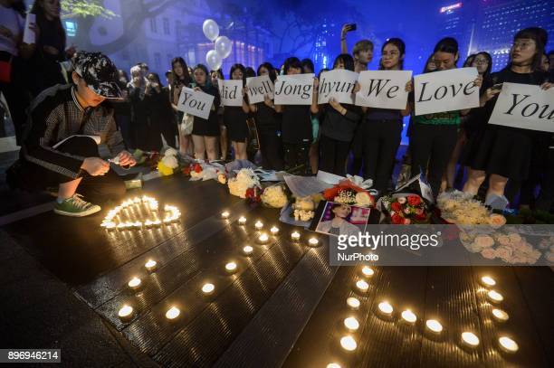 Malaysian Kpop fans gather for vigil after the death of Kim JongHyun a 27yearold lead singer of the massively popular Kpop boyband SHINee in Kuala...
