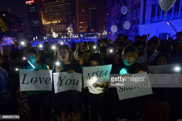 Malaysian Kpop fans react as they gather for vigil after the death of Kim JongHyun a 27yearold lead singer of the massively popular Kpop boyband...