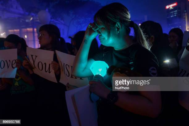 A Malaysian Kpop fans reacts as she gather for vigil after the death of Kim JongHyun a 27yearold lead singer of the massively popular Kpop boyband...