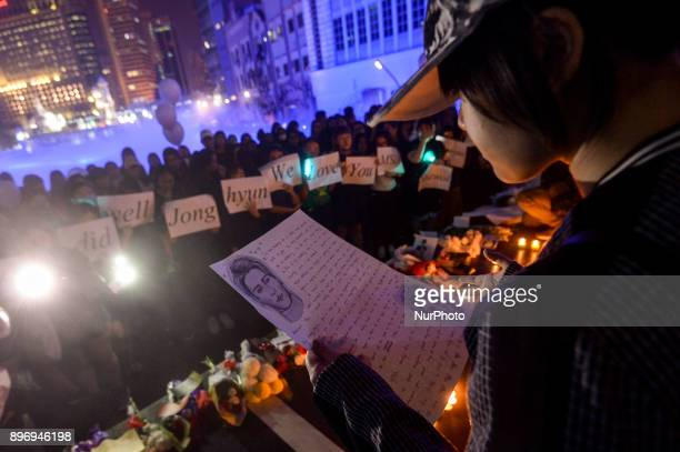 A Malaysian Kpop fans reads a letter as they gather for vigil after the death of Kim JongHyun a 27yearold lead singer of the massively popular Kpop...