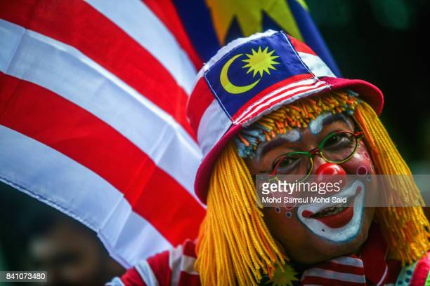 Malaysian man has his face painted during Malaysian celebrations at Merdeka Square on August 31 2017 in Kuala Lumpur Malaysia Hari Merdeka is a...