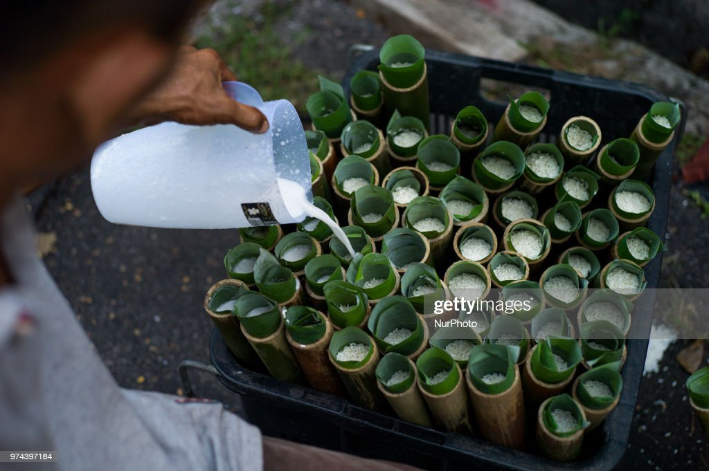 Malaysian man prepares 'Lemang', which is a traditional food made of glutinous rice, coconut milk and salt, cooked in a hollowed bamboo stick lined with banana leaves in order to prevent the rice from sticking to the bamboo for the Eid al-Fitr celebration in Kuala Lumpur, Malaysia on June 14, 2018. Eid al-Fitr is an important religious holiday celebrated by Muslims worldwide that marks the end of Ramadan, the Islamic holy month of fasting.