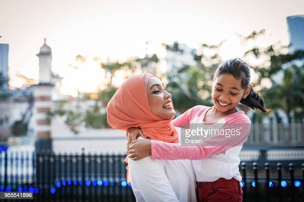 Malaysian mature woman with daughters after school