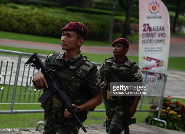 Malaysian military personnel patrol at the venue for the 27th Association of Southeast Asian Nations Summit at the Kuala Lumpur Convention Centre on...