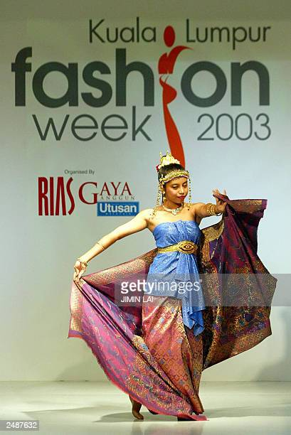 Malaysian model display the latest Malay cultural 'Songket' collection by a local designer during the launch of a fashion week in Kuala Lumpur 01...