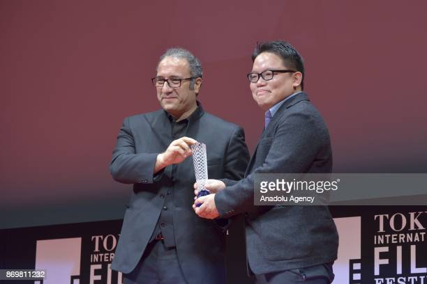 Malaysian movie director Edmund Yeo winner the Award for Best Director for the movie 'Aqerat ' during the closing ceremony of the 30th Tokyo...