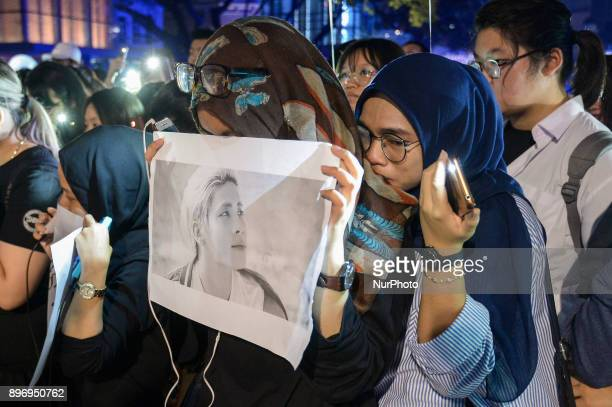 Malaysian Muslim Kpop fans react as they gather for vigil after the death of Kim JongHyun a 27yearold lead singer of the massively popular Kpop...