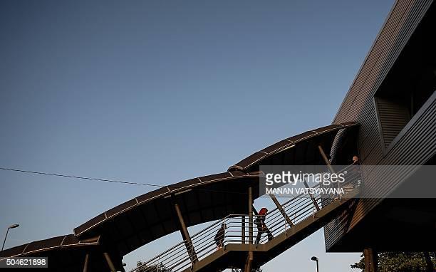 A Malaysian Muslim woman walks up the stairs to a trainstation in Kuala Lumpur on January 12 2016 AFP PHOTO / MANAN VATSYAYANA / AFP / MANAN...