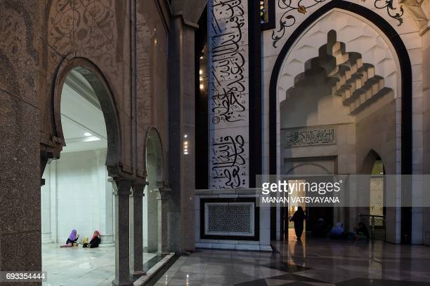 Malaysian Muslim women break their fast during the holy month of Ramadan at the Wilayah mosque in Kuala Lumpur on June 7 2017 Tens of millions across...