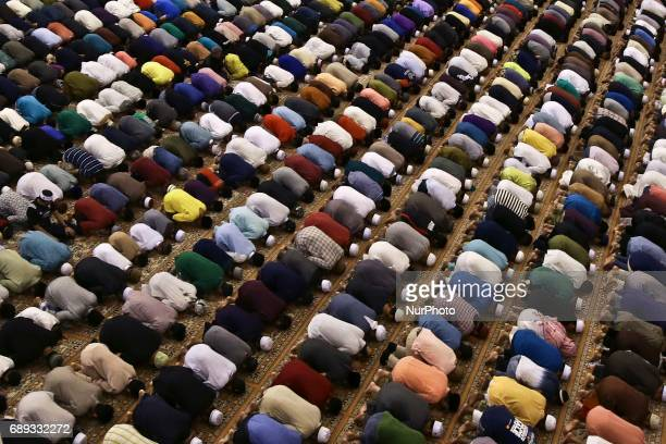 Malaysian Muslims attend tarawih prayer at Federal Territory Mosque Kuala Lumpur Malaysia mark the holy fasting month of Ramadan on 27 May 2017