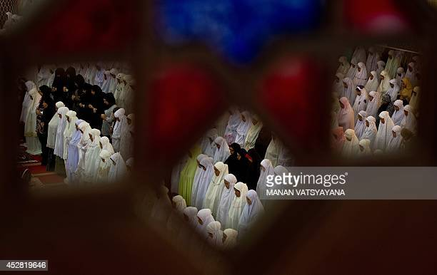 Malaysian Muslims offer Eid alFitr prayers at the national mosque in Kuala Lumpur on July 28 2014 Malaysia marked a grim Eid alFitr Islam's biggest...