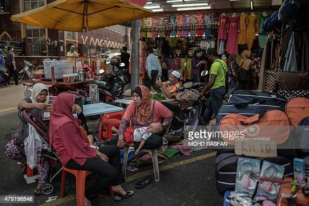 Malaysian Muslims wait to break their fast during the Muslim holy fasting month of Ramadan in Kuala Lumpur on July 2 2015 Islam's holy month of...