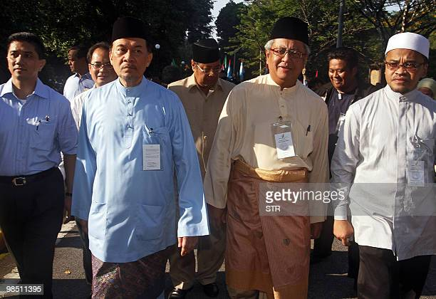 Malaysian opposition leader Anwar Ibrahim and Zaid Ibrahim , candidate for Parti Keadilan Rakyat , arrive for the nomination process for the Hulu...