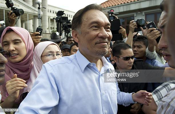 Malaysian opposition leader Anwar Ibrahim celeberates the court decision with his daugther Nurul Izzah outside the court in Kuala Lumpur on January 9...