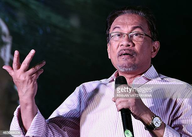 Malaysian opposition leader Anwar Ibrahim gestures while addressing his supporters at a gathering in Kuala Lumpur on February 9 2015 Malaysia's...