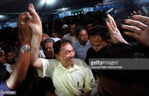 Malaysian opposition leader Anwar Ibrahim is greeted by his supporters as he leaves a gathering on December 14 2010 in Kuala Lumpur Malaysia Anwar...