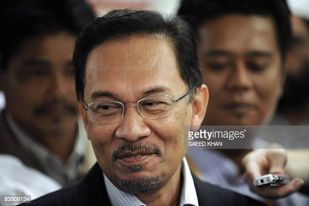 Malaysian opposition leader Anwar Ibrahim talks with media while leaving the court in Kuala Lumpur on October 31 2008 Anwar who faces trial over...