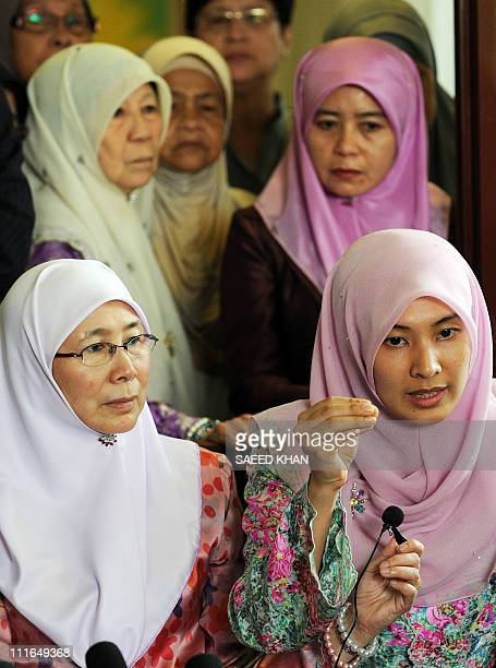 Malaysian opposition leader Anwar Ibrahim's daughter Nurul Izzah along with her mother Wan Azizah and other family members speaks at a press...