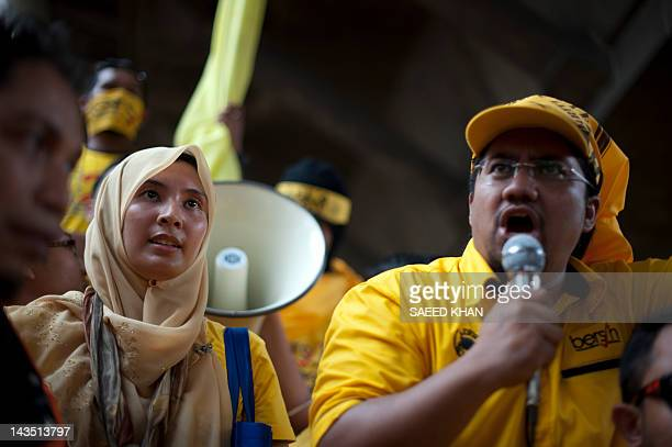 Malaysian opposition leader Anwar Ibrahim's daughter Nurul Izzah waits to address the crowd during an antigovernment rally near the historical...
