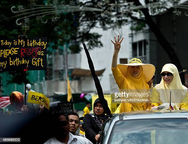Malaysian opposition leader Wan Azizah the wife of jailed Anwar Ibrahim and her daughter Nurul Izzah take part in an antigovernment rally near...