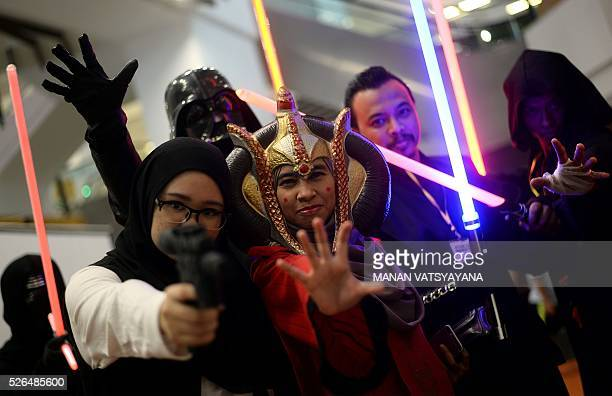 Malaysian participants dressed as popular 'Star Wars' characters pose during an event to mark the Star Wars Day celebration in Kuala Lumpur on April...