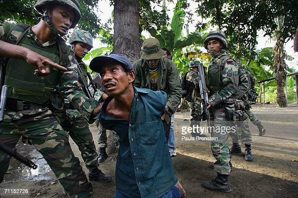 Malaysian peacekeeping troops arrest Julio a suspected gang member that they believe has torched houses on June 8 2006 in Dili East Timor Australia...