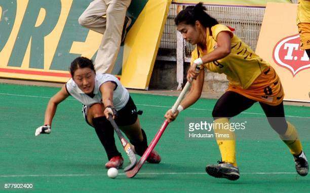 Malaysian player and Azerbaijan player in action during Lal Bahadur Shastri Four nation hockey tournament at Shivaji stadium in New Delhi on Sunday