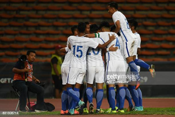 Malaysian players celebrate after scoring a goal against Brunei during their men's football Group A match at the 29th Southeast Asian Games at Shah...