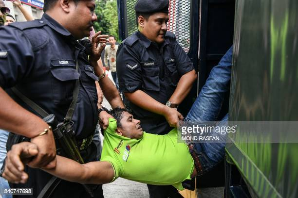 Malaysian police detain a demonstrator during a protest against the persecution of Muslim ethnic minority Rohingya in Myanmar in Kuala Lumpur on...