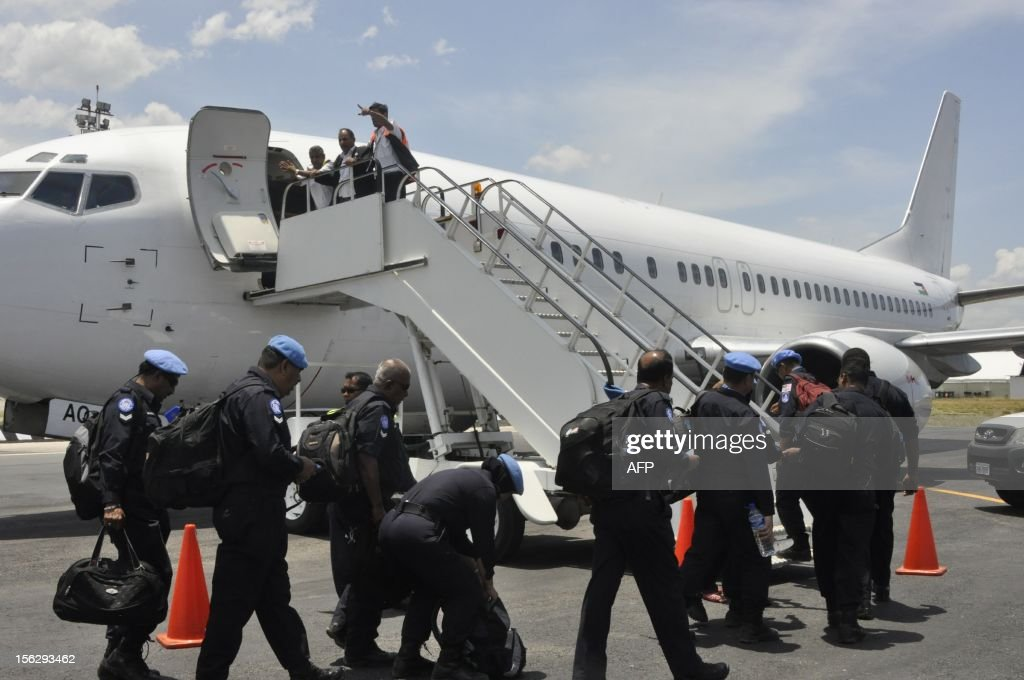 Malaysian police officers incorporated in the UN Peacekeeper, leave for Kuala Lumpur, in Dili on November 13, 2012. UN peacekeepers in East Timor on October 31 handed full responsibility for policing to Asia's youngest nation, Prime Minister Xanana Gusmao announced. East Timor, an impoverished half-island nation of 1.1 million despite bountiful oil and gas reserves off its coasts, in May celebrated a decade of formal independence after a 24-year occupation by Indonesia. AFP PHOTO / VALENTINO DE SOUSA / AFP PHOTO / Valentino Dariell DE