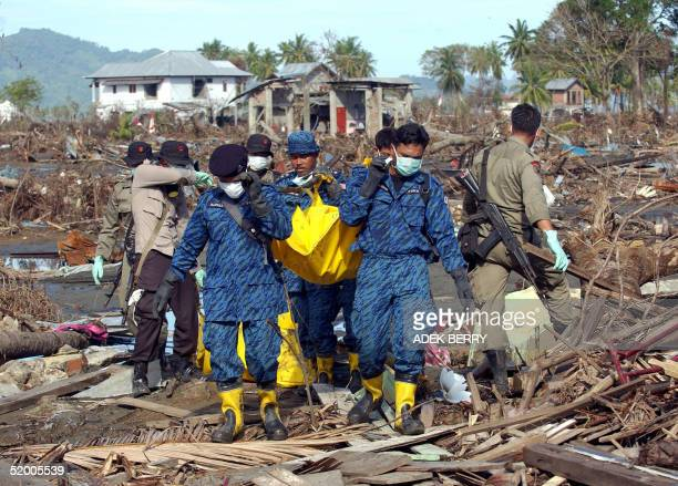 Malaysian police troops evacuate tsunami victim bodies together with Indonesian police in Banda Aceh 18 January 2005 Indonesian has told Malaysia...