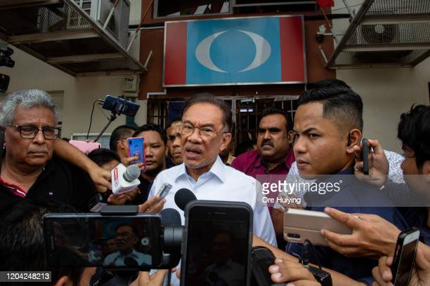 Malaysian politician Anwar Ibrahim speaks to the media outside the headquarter of People's Justice Party on March 1 2020 in Kuala Lumpur Malaysia