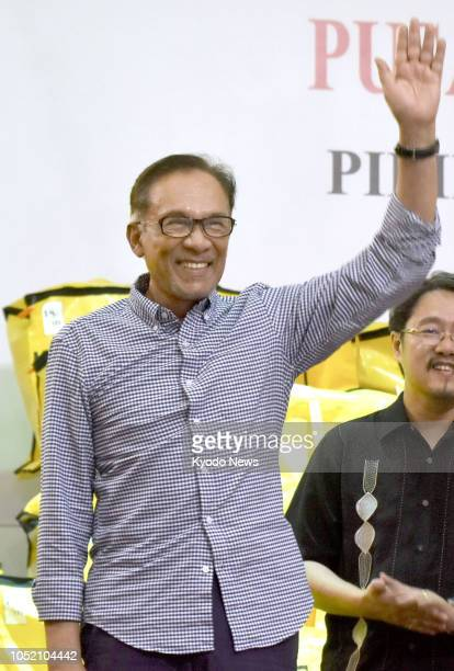Malaysian politician Anwar Ibrahim waves to his supporters after winning a landslide victory in a byelection in the seaside resort town of Port...