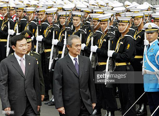 Malaysian Prime Minister Abdullah Ahmad Badawi along with his Thai counterpart Thaksin Shinawatra inspect a guard of honour at the Government House...
