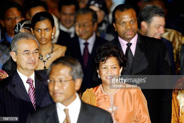 Malaysian Prime Minister Abdullah Ahmad Badawi together with his wife Jeanne Abdullah and Swaziland King Mswati III arrive at the banquet hall during...