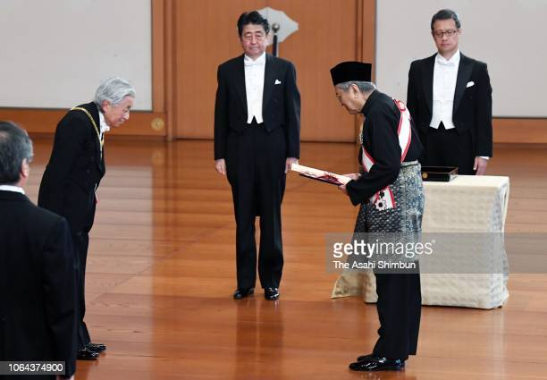 Malaysian Prime Minister Mahathir Bin Mohamad receives the Grand Cordon of the Order of the Paulownia Flowers from Emperor Akihito during the Grand...