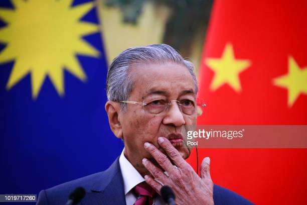 Malaysian Prime Minister Mahathir Mohamad gestures as he speaks to reporters during a press conference at the Great Hall of the People in Beijing,...