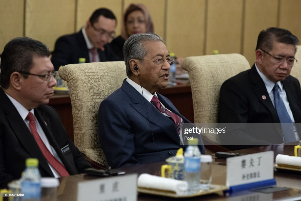 Malaysian Prime Minister Mahathir Mohamad (C) speaks to Chinese President Xi Jinping (not pictured) during their meeting at Diaoyutai State Guesthouse on August 20 2018 in Beijing, China.