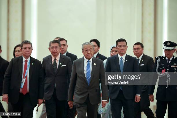Malaysian Prime Minister Mahathir Mohamad walks towards Chinese President Xi Jinping before a bilateral meeting of the Second Belt and Road Forum at...