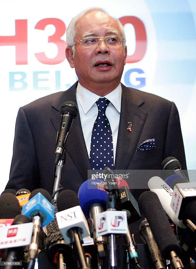 Malaysian Prime Minister Najib Abdul Razak updates the media on the search and rescue plan for the missing MAS Airlines flight MH370 during a press conference on March 15, 2014 in Kuala Lumpur, Malaysia. During the press conference the Prime Minister said that investigators had discovered evidence from satellite and radar systems indicating that the communication systems of the aircraft had been intentionally disabled. The search for the plane in the South China Sea has now been abandoned with the focus switching to two flight corridors, the first stretching from the border of Kazakhstan and Turkmenistan to northern Thailand and a second stretching from Indonesia to the South Indian Ocean.The missing aircraft was carrying 227 passengers and 12 crew.