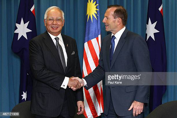 Malaysian Prime Minister Najib Razak and Australian Prime Minister Tony Abbott shake hands before a bilateral meeting held at the Commonwealth...