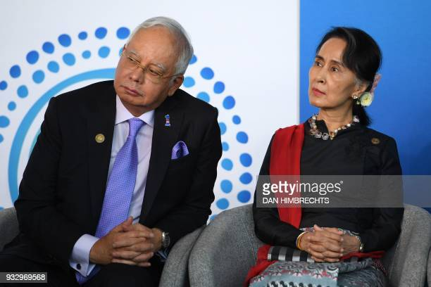 Malaysian Prime Minister Najib Razak and Myanmar State Counsellor Aung San Suu Kyi listen to an address as they attend the New Colombo Plan Reception...