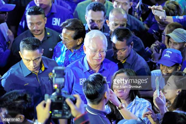Malaysian Prime Minister Najib Razak is suurounded by supporters during an election campaign rally on May 6, 2018 in Kota Kinabalu, Malaysia....