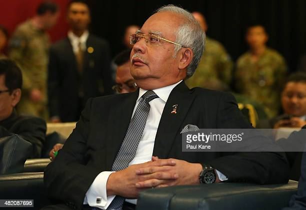 Malaysian Prime Minister Najib Razak looks on as Air Chief Marshall Angus Houston commence his briefing about the search mission for the missing...